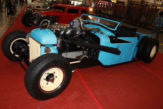 blue hot rod with old engine....