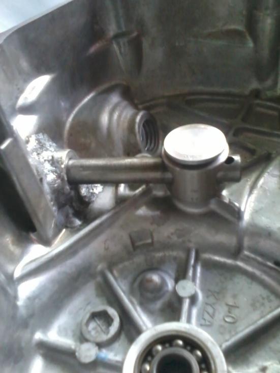 inti dari kopling manual...bikin stut penekan...as kopling pake Honda tiger lubang atas harus dilas argon dan plendes penekan bikin ditukang bubut...tebal plendesnya 22mm....